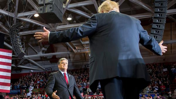 President Trump greets talk show host Sean Hannity at a 2018 rally in Cape Girardeau, Mo.