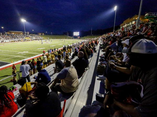 Fans follow coronavirus safety guidelines as they attend a football game on August 22 in Alabaster, Ala.