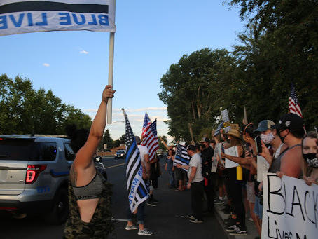 Protesters — on one side, Black Lives Matter and on the other, Trump backers — face off in Prineville, Ore., after a Black woman and the police chief posted contradicting videos about their meeting.