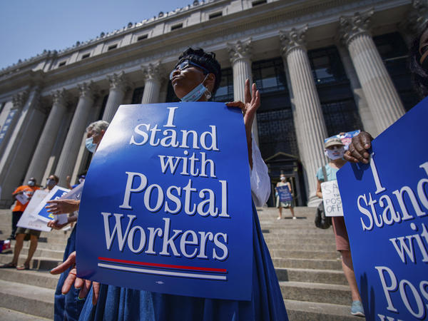 Retired postal worker Glenda Morris protests postal cutbacks on Aug. 25 in New York. African Americans make up 27% of the Postal Service, about twice their share of the overall workforce.