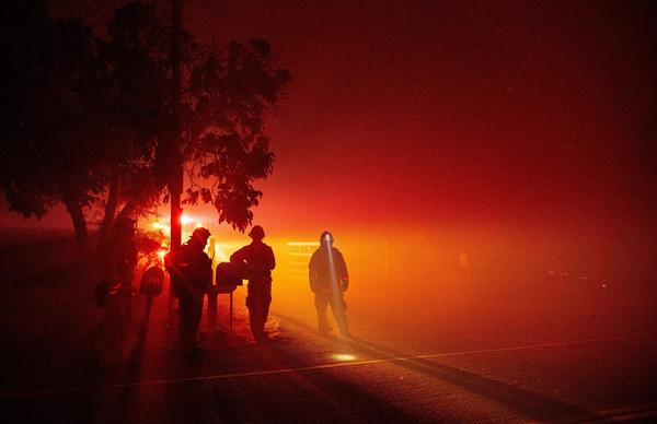Firefighters in the valley area of Vacaville, in northern California, during the LNU Lightning Complex fire on Aug. 19.