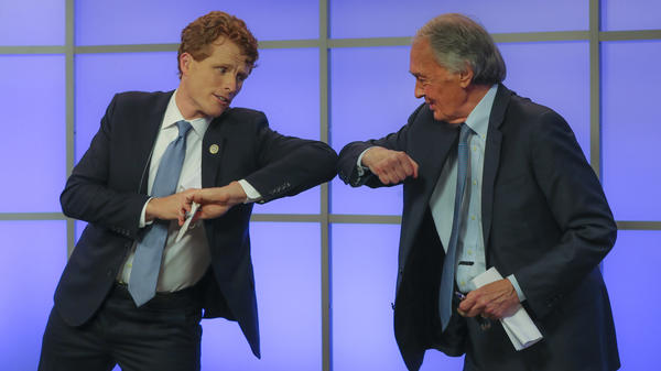Rep. Joe Kennedy III (left) bumps elbows with Sen. Ed Markey after their Democratic Senate primary debate on June 1 in Springfield, Mass.