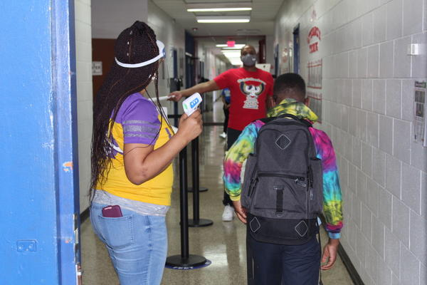A temperature checkpoint at Dwight D. Eisenhower Charter School in Algiers. A limited number of students are attending the school's learning hub while regular in-person operations are suspended.