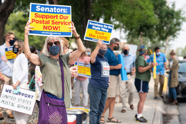 Clancy resident Jane Amdahl supports the U.S. Postal Service at a Helena rally Aug. 25, 2020. Attendees urged the U.S. Senate to pass a USPS relief package following controversial changes within the agency.