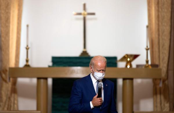 Democratic presidential nominee Joe Biden speaks Thursday at Grace Lutheran Church in Kenosha, Wis.