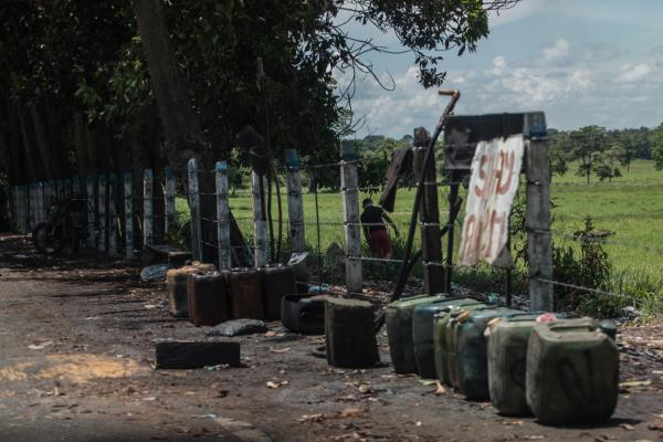 Contraband fuel sits on the side of a road in Puerto Santander, Colombia, on May 31, 2019. The Venezuelan government's lack of cash to import gasoline combined with U.S. sanctions targeting the oil sector have led to chronic fuel shortages in Venezuela. That has upended a long-running, lucrative contraband gas trade.
