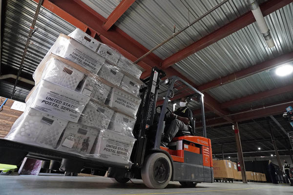 A forklift operator loads absentee ballots for mailing Thursday at the Wake County Board of Elections in Raleigh, N.C. North Carolina is scheduled to begin sending out more than 600,000 requested absentee ballots to voters on Friday.
