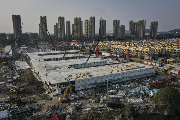 On Jan. 23, workers started building the Huoshenshan hospital for COVID-19 patients in Wuhan, China. The photo above was taken on Jan. 30. Construction was done on Feb. 2, and the 1,000-bed hospital opened on Feb. 3. Today it stands empty of patients.
