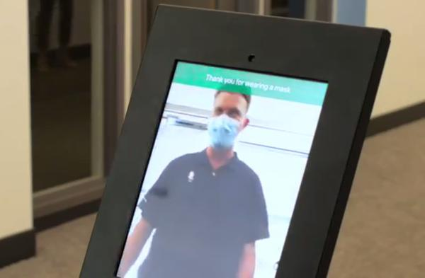 Screen grab from a Nomad Go demo video showing a kiosk that monitors mask compliance at a building entry.