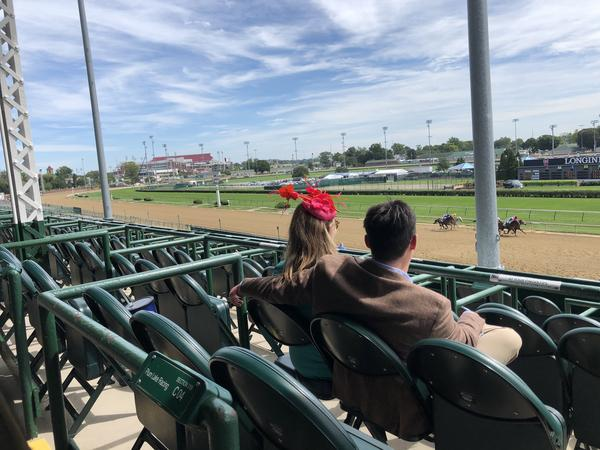 Spectators in an otherwise empty grandstand watch the Kentucky Oaks at Churchill Downs on Sept. 4. Oaks is typically a daylong party, a kick-off to the Kentucky Derby, which runs the following day.