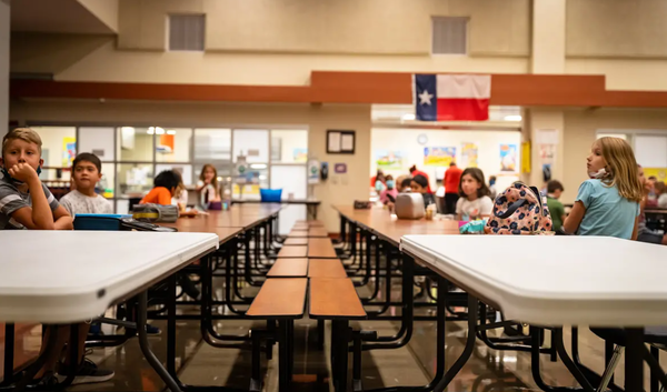Students sit distanced from one another in the lunch room at Jacob's Well Elementary School in Wimberley.
