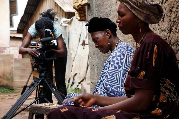 Rosine Mbakam, left, says she chose to shoot all images and sound herself to maintain an equal relationship with the subjects of her films.