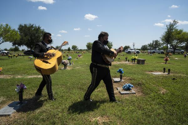 Hector Guerra, right and Juan Carlos Sanchez, from El Mariachi Continental, make their way to a funeral service in Donna, Texas on Aug. 21.
