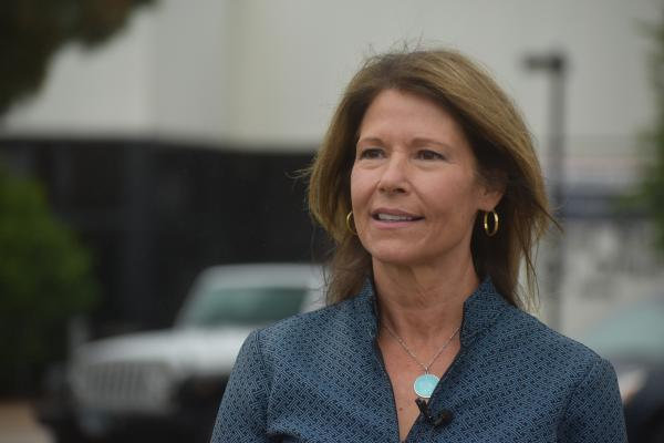 U.S. Rep. Cheri Bustos (D-Moline) speaks outside the U.S. Postal Service Sorting and Distribution Facility on State Street in Peoria, 9/8/20.