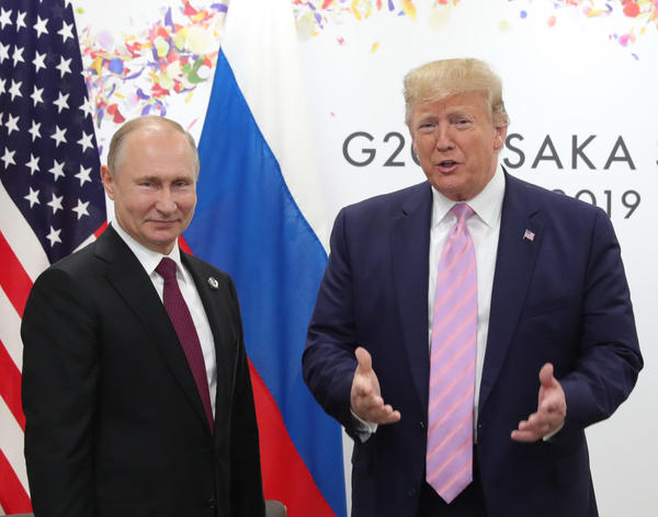 Russian President Vladimir Putin and U.S. President Donald Trump hold a meeting on the sidelines of the G20 summit in Osaka on June 28, 2019. (Mikhail Klimentyev/AFP via Getty Images)