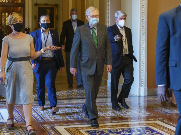 Senate Majority Leader Mitch McConnell of Ky., center, introduced a targeted coronavirus relief bill and said he planned a vote this week on it.