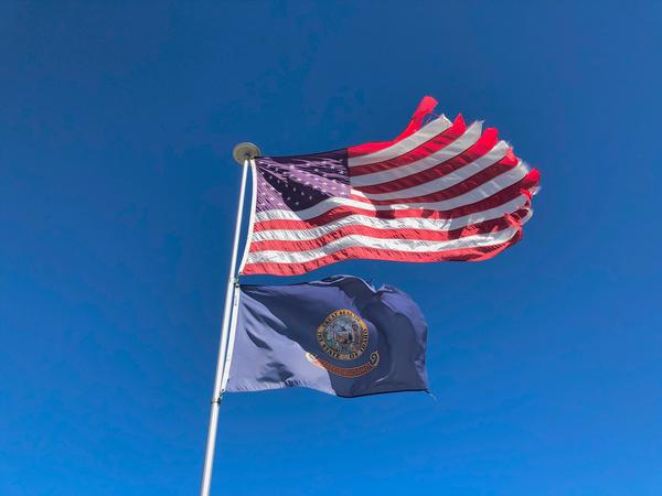 Two flags fly above the library in Leadore, Idaho.