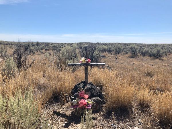 A cross sits along the side of the road outside of Rexburg, Idaho.