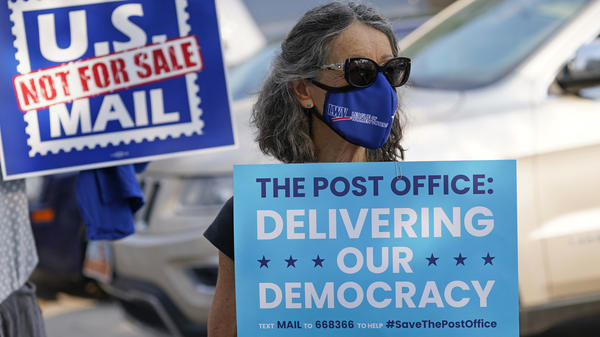 """Postmaster General Louis DeJoy says it's his """"sacred duty"""" to ensure election mail delivery this fall."""