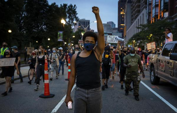 Mass. Action Against Police Brutality protesters march down Tremont Street Wednesday night. (Robin Lubbock/WBUR)