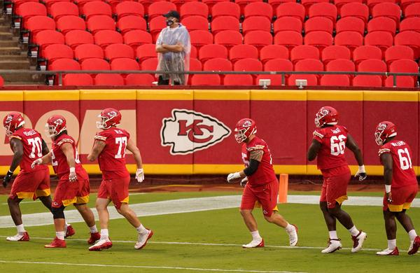 In this Aug. 29 file photo, Kansas City Chiefs players run during NFL football training camp at Arrowhead Stadium in Kansas City, Mo.