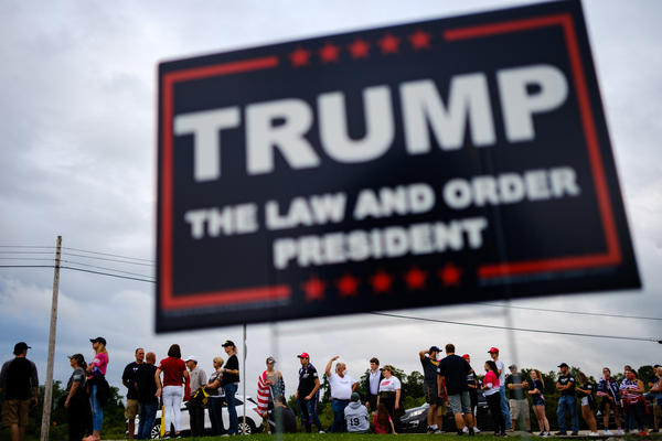 Supporters of President Trump line up outside of Arnold Palmer Regional Airport to get into a Sept. 3 rally in Latrobe, Pa.
