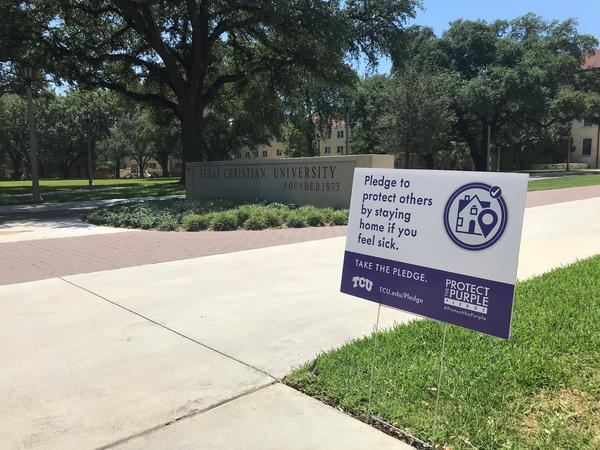 During move-in week at TCU, signs placed around campus urged students to keep themselves and others safe from the spread of COVID-19.