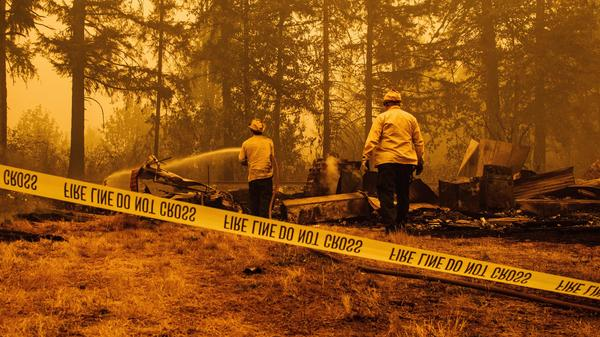 Firefighters try to control the Santiam Fire in Mill City, Ore., on Thursday. About 500,000 people have been evacuated in the state as fires ravage some 900,000 acres.