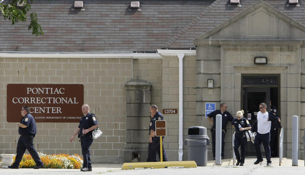 Corrections officers leave the Pontiac Correctional Center during a shift change in 2008.