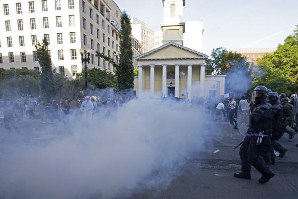 Police move in on demonstrators in Lafayette Square near the White House with tear gas and smoke on June 1. U.S. Park Police made announcements asking protesters to leave, but few people appeared to hear them.