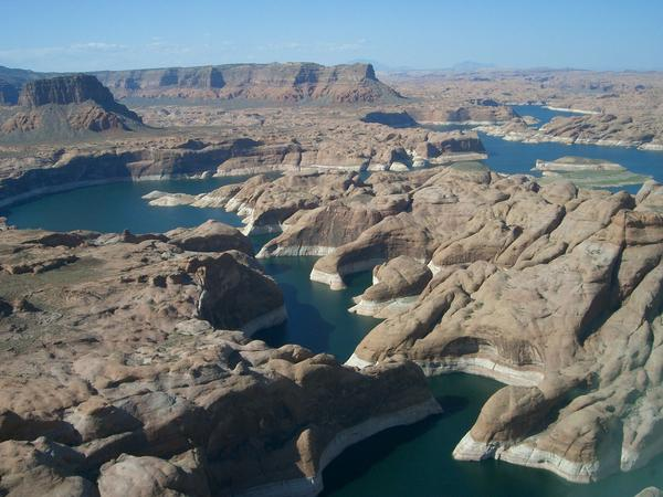 Lake Powell is a man-made reservoir on the Colorado River in Southeast Utah and Northwest Ariz. It is inside the Glen Canyon Recreation Area, which was visited by over 4 million people in 2019.