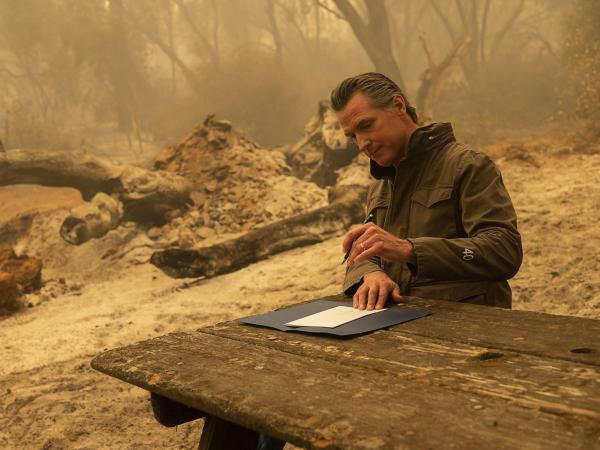 California Gov. Gavin Newsom signs Assembly Bill 2147 after he toured the North Complex Fire zone on Friday.  The bill allows inmates who have worked as firefighters to ask the court to dismiss their charges to make it easier for them to find a job once they are released. People convicted of certain violent or sex crimes would not be eligible.