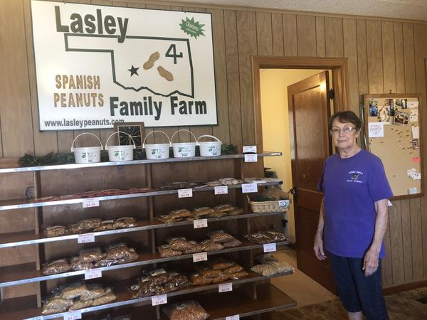 Zelma Lasley stands by shelves of peanuts and sweets at the family's farm in Eakly, Oklahoma. The peanuts are typically sold at the Oklahoma State Fair in the Made in Oklahoma Booth.