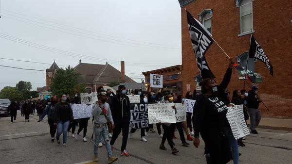 Demonstrators marching down Carroll St on their way to Chandler Park