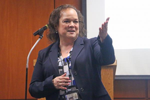 State Superintendent Carmen Ayala speaking prior to the pandemic.