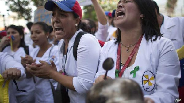 FRONTLINE FEAR Venezuelan nurses protest in Caracas for better COVID-19 protection resources from their socialist regime.