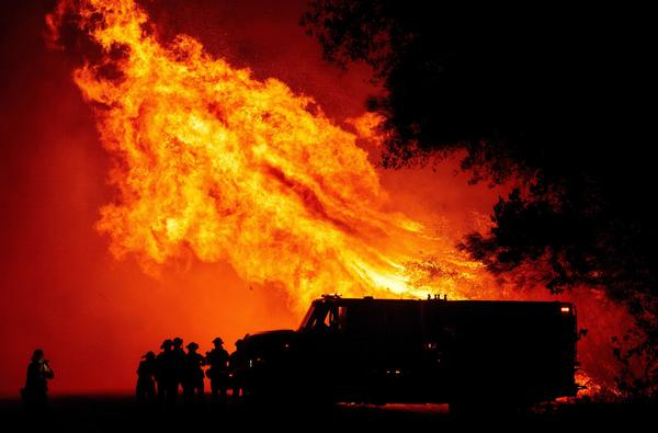 Butte county firefighters watch as flames tower over their truck during the Bear fire in Oroville, California on September 9, 2020. (JOSH EDELSON/AFP via Getty Images)