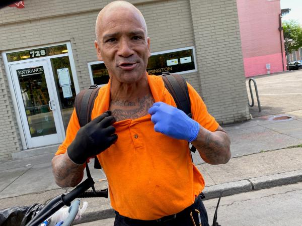 """Bobby Parker, showing off his tattoo that reads """"Only God Can Judge Me,"""" says he had to sleep outside when he was locked out of his New Orleans home."""