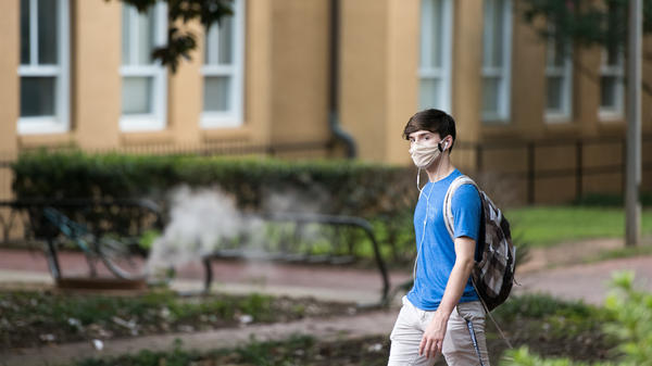 A student walks on campus at the University of South Carolina. During the final week of August, the university reported a 26.6% positivity rate among the student population tested for the coronavirus.