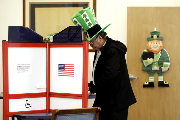 A voter fills out his ballot, taking advantage of early voting, Sunday, March 15, 2020, in Steubenville, Ohio.