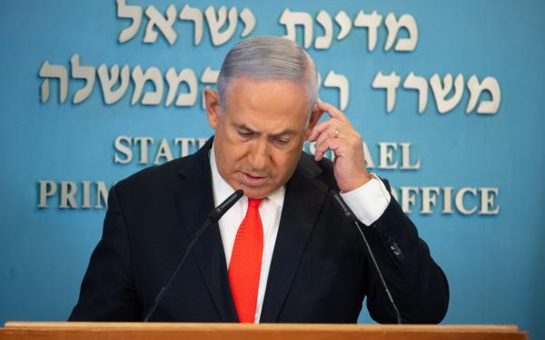 Israeli Prime Minister Benjamin Netanyahu gives a briefing on coronavirus developments in Israel at his office in Jerusalem.