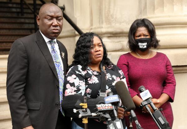 Breonna Taylor's mother Tamika Palmer (C) addresses the media over the speed of the investigation of her daughter's death as attorney Benjamin Crump (L) and co-counsel Lonita Baker (R) looks on outside Louisville City Hall in Louisville, Kentucky.