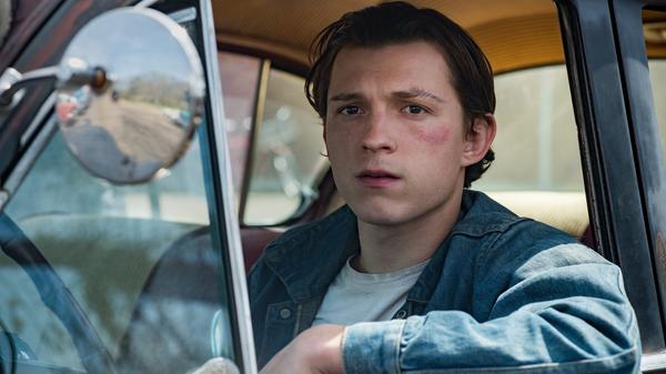 Tom Holland plays Arvin, a young man who refuses to let evil go unpunished in <em>The Devil All the Time. </em>