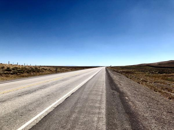 A lonely stretch of road to cycle in Wyoming.