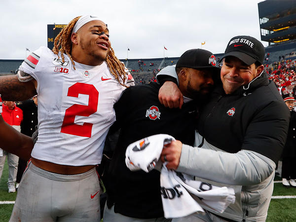 Ohio State defensive end Chase Young (2), linebackers coach Al Washington and head coach Ryan Day celebrate after a 56-27 win against Michigan after an NCAA college football game in Ann Arbor, Mich., Saturday, Nov. 30, 2019.