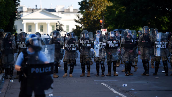 Military police hold a line near the White House on June 1 as demonstrators gather to protest police brutality in Washington, D.C.
