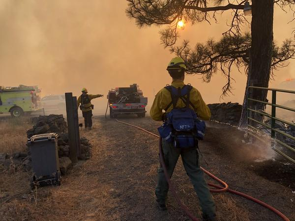 Firefighters work a fast-moving fire Sept. 7, 2020, that started in Spokane County and moved to Whitman County, destroying much of the town of Malden.