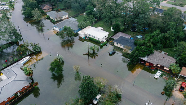 An aerial photo shows mass flooding in West Pensacola near the Bayou Grove and Mulworth neighborhoods in Florida. The area was hit hard by Hurricane Sally, which continues to cause flooding threats.