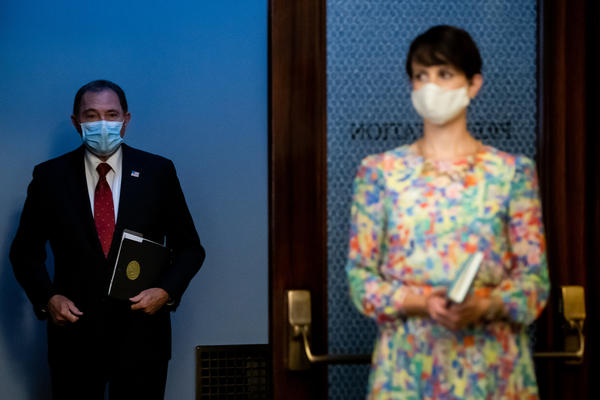 Gov. Gary Herbert and state epidemiologist Dr. Angela Dunn arrive for a press briefing at the Capitol in Salt Lake City on Wednesday, July 22, 2020.