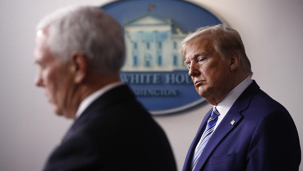 President Trump listens as Vice President Pence speaks during a coronavirus task force briefing in April. A former Pence aide said Trump prioritized his reelection over concern for people getting sick.